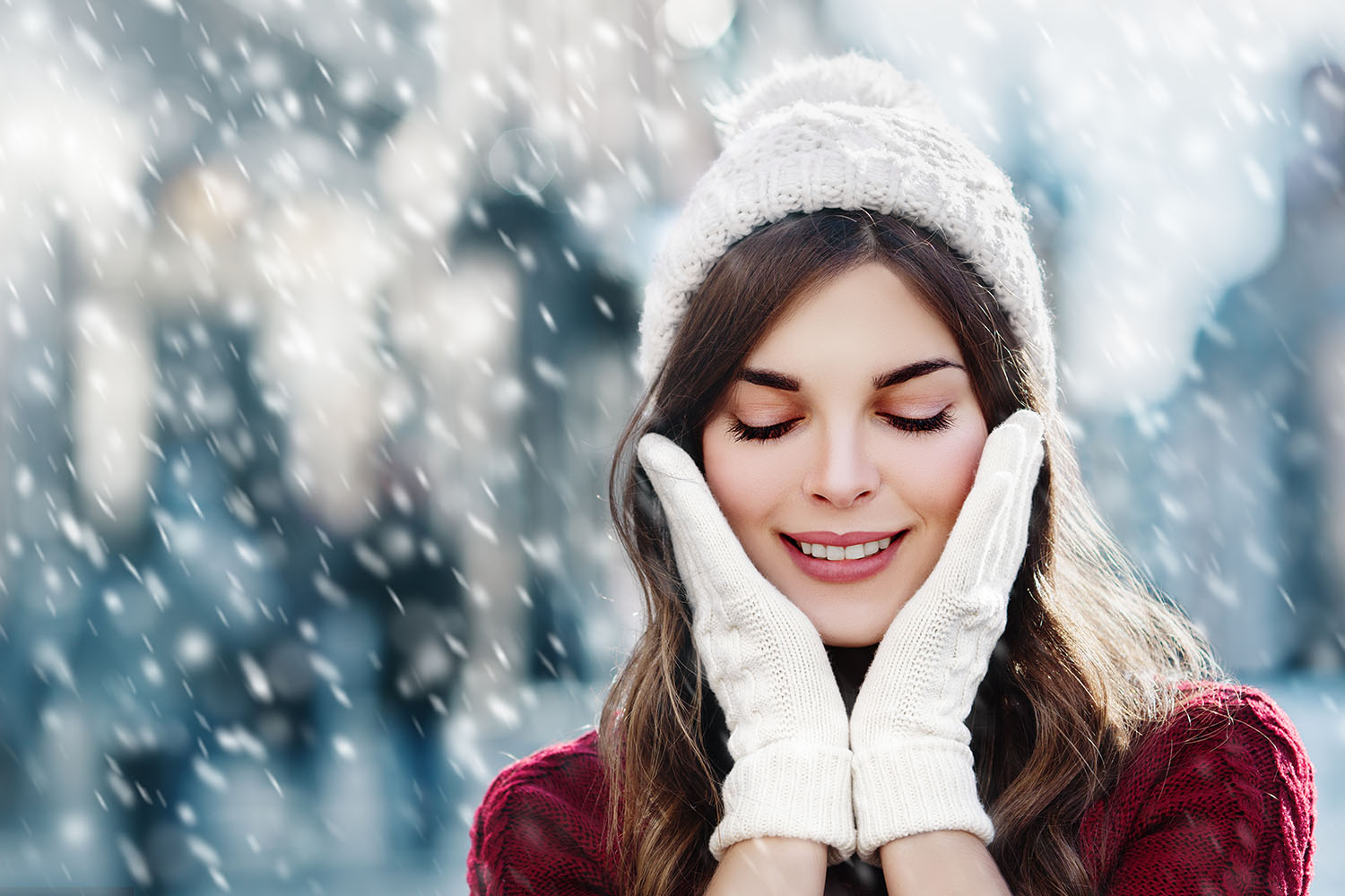 Picture of girl in hat in gloves standing out in the snow