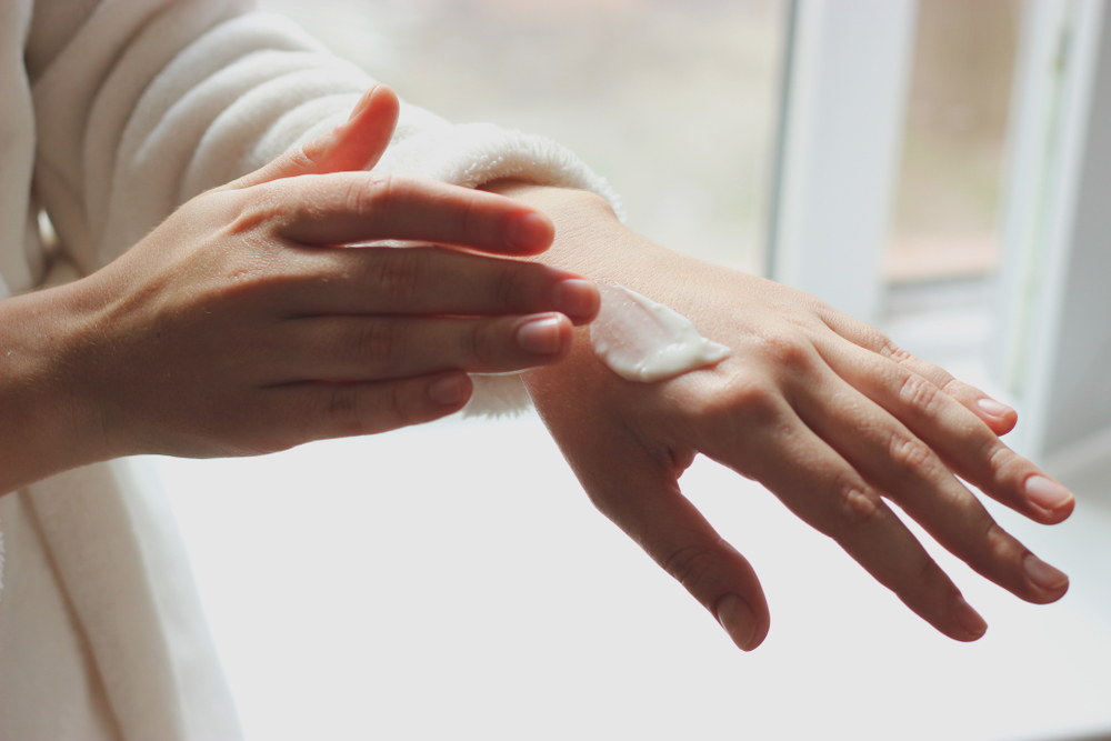 Patch-testing cosmetic cream on skin.