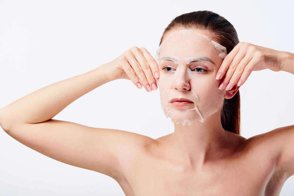 Woman wearing K-beauty face mask