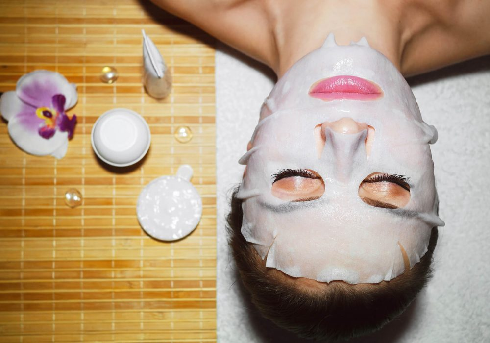 Woman laying down while wearing a natural face mask