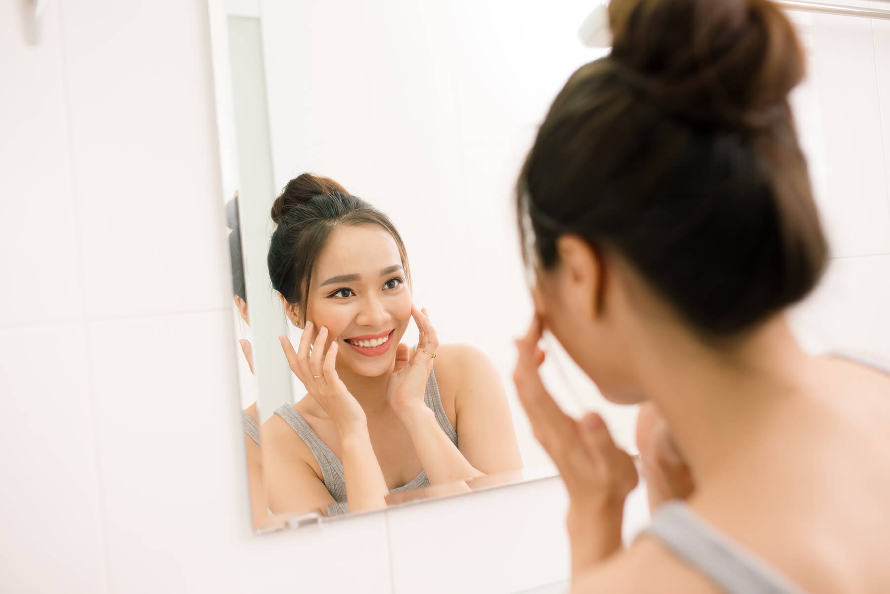 Young woman smiling in mirror