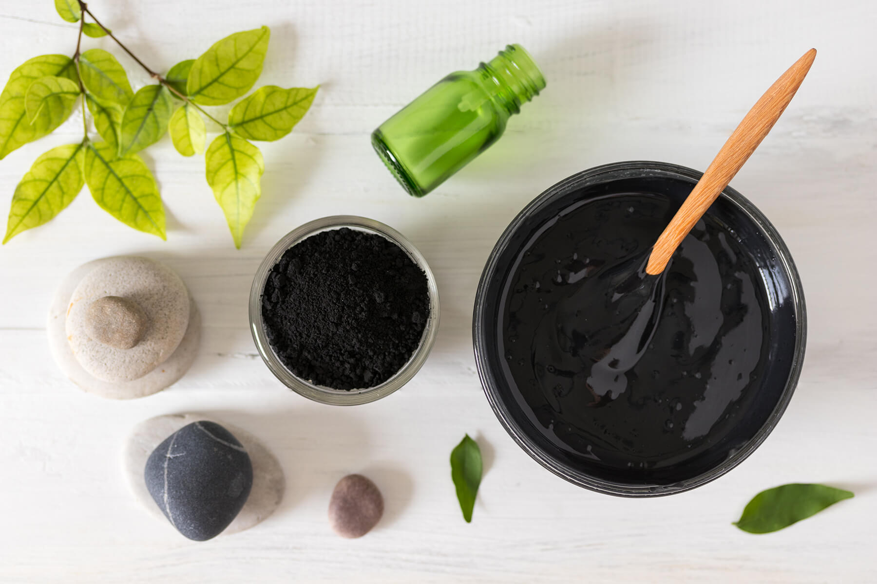 Charcoal face mask ingredients on a table