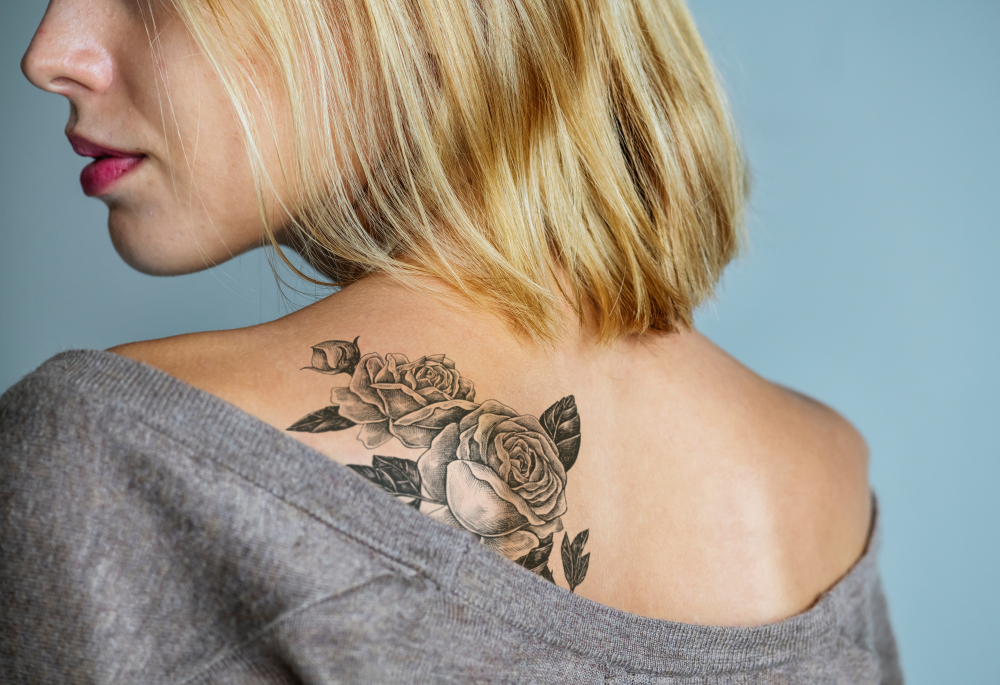 Young woman's back with a tattoo